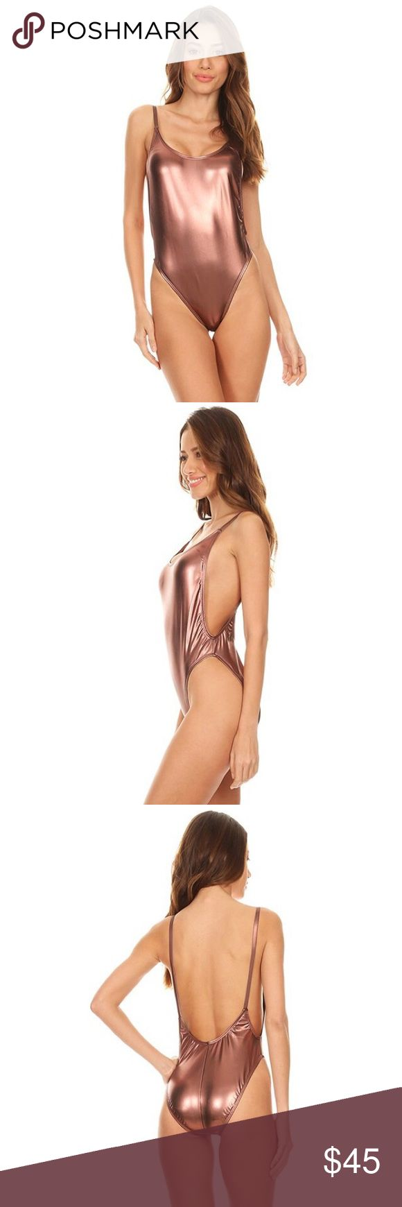 BRONZED BEAUTY Bathing suit Loving this rose gold color and it will go so perfectly with that tanned look you're trying to achieve. One piece high cut vintage swimsuit. Cheeky back bottom.  ➖MATERIAL: Nylon & Spandex ➖MADE IN USA ▫️PRICE FIRM Swim One Pieces