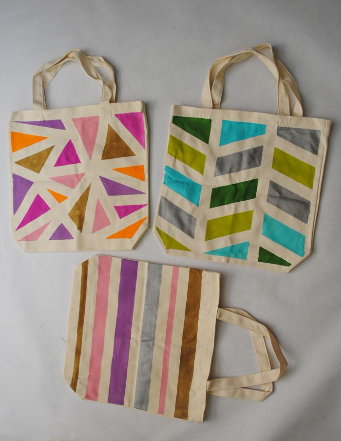 DIY: Geometric Painted Tote Bags - looks like all it is is painter's tape and fabric paint, could work on shirts and other things too!