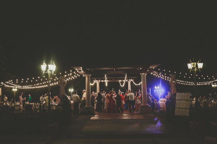 Night time dancing during this vineyard wedding reception under the twinkling plaza lights. The outside wedding venue at Mount Palomar Winery in Temecula  is lit with string lights and beautiful classic lanterns. #mountpalomarwinery