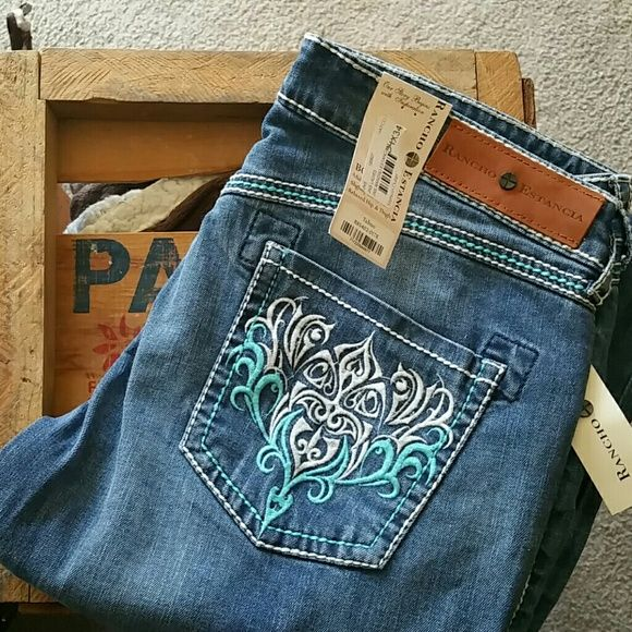 Rhinestone Western Jeans!! Very cute western jeans new with tags, never worn 34x34. Blue and white stitching. Jeans
