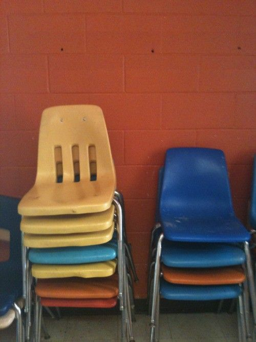 Vintage plastic and metal stacking chairs - most schools had these in the late 1970s, early 1980s .