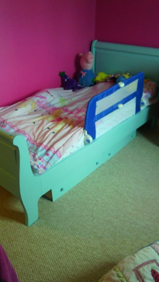I painted the drawers left over from chest of drawers to match the bed.  So we have more storage and it matches at  no cost. Paint is called milk jug its by Earthborn and its an eggshell. kids room blue hot pink.