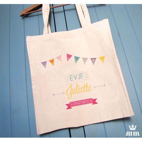 Tote bag EVJF Fanion, cadeau idéal pour la future mariée et ses amis présentes pour l'enterrement de vie de jeune fille (EVJF)... Ce tote bag personnalisé est un souvenir original à conserver.