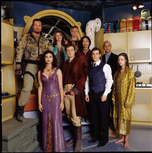 Adam Baldwin, Nathan Fillion, Ron Glass, Sean Maher, Jewel Staite, Gina Torres, Alan Tudyk, Morena Baccarin, and Summer Glau in Firefly (2002)