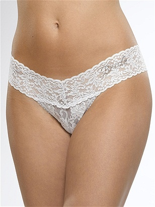 Lowrise Thong in White by Hanky Panky at Pesca Trend. Hanky Panky's signature lace thong sits lower on the hips. The world's most comfortable thong features a flattering V waistband. Offers no visible panty line. Thong provides minimal coverage in the back. Available in white. Body made from 100% nylon, trim from 90% nylon and 10% spandex, and lining made from 100% cotton in the USA by Hanky Panky.