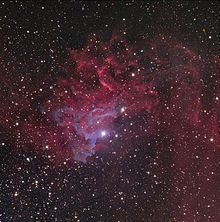 Flaming Star Nebula, an emission/reflection nebula is 1,500 light years away in the constellation Auriga.  It is 51 light years across.