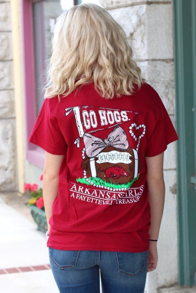 Arkansas girls are a treasure! Short sleeve t-shirt featuring football, pearls, a bow, and the Arkansas Razorbacks! Super cute design with full back and left chest graphics. Cardinal red in color.