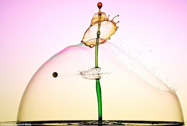 High Speed Photographs Capture Bullets Bursting Colorful Water Plumes | The Creators Project