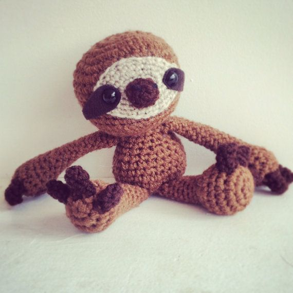 ***** PLEASE NOTE - THIS IS A PATTERN ONLY. THE PRODUCT FOR SALE IS A DIGITAL PDF WITH INSTRUCTIONS, NOT THE PHYSICAL DOLLS SHOWN *********   Spend a lazy day with your very own sloth family! This CROCHET PATTERN includes instructions to make an adult and baby sloth.   ~~~ PATTERN INFO ~~~  Final Size: Adult sloth is approx. 8.5in tall when standing (Approx. 6in when seated) & approx. 3 inches for baby sloth  Difficulty Level: Advanced Beginner - Intermediate  Skills Needed: Joining in ro...