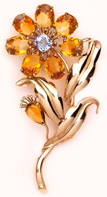 dramatic and rare citrine, sapphire  and pink gold brooch. Cartier.