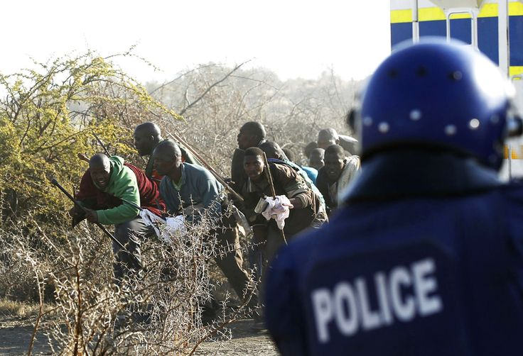 Marikana: A year on | Moments before the massacre, mine workers confront police. Photo: Siphiwe Sibeko, Reuters