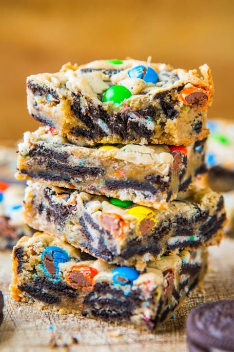 """LOADED M&M OREO COOKIE BARS Here's the """"kitchen sink"""" version of cookie bars: chopped Oreos, M&M's, chocolate chips, and buttery, dense cookie dough. Substitute with whatever candies you have lying around the cupboard or throw 'em all in the mix."""