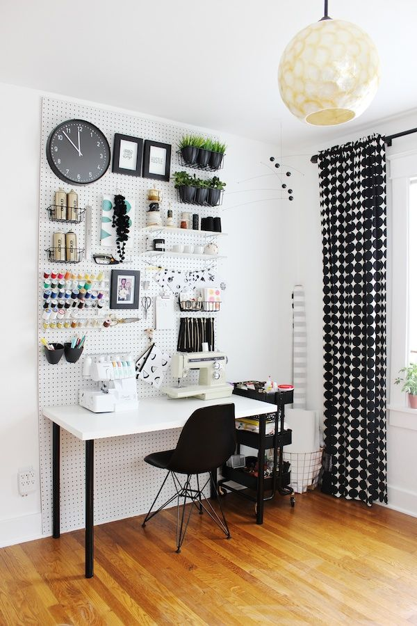 Creative ways to deal with desk clutter: How to create a peg board wall to hang everything from craft supplies to files, art, even plants -- and get it all off your desk! | via Fabric Paper Glue
