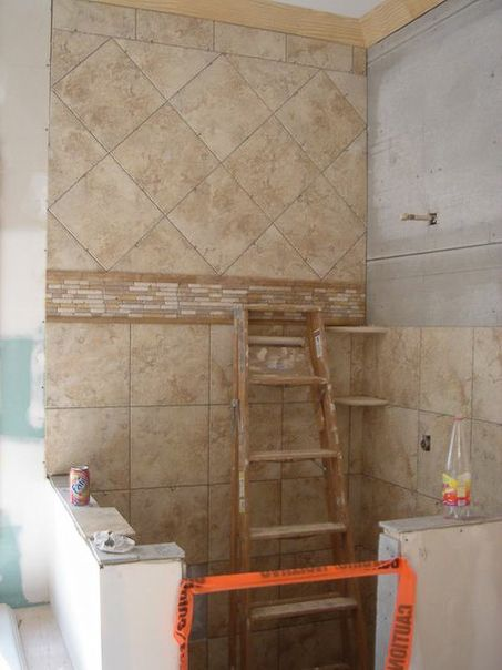 Bathroom Shower Tile- Natural tones, accent border mosaic with (top  diagonal & bottom straight) also love the corner shelf ideas!