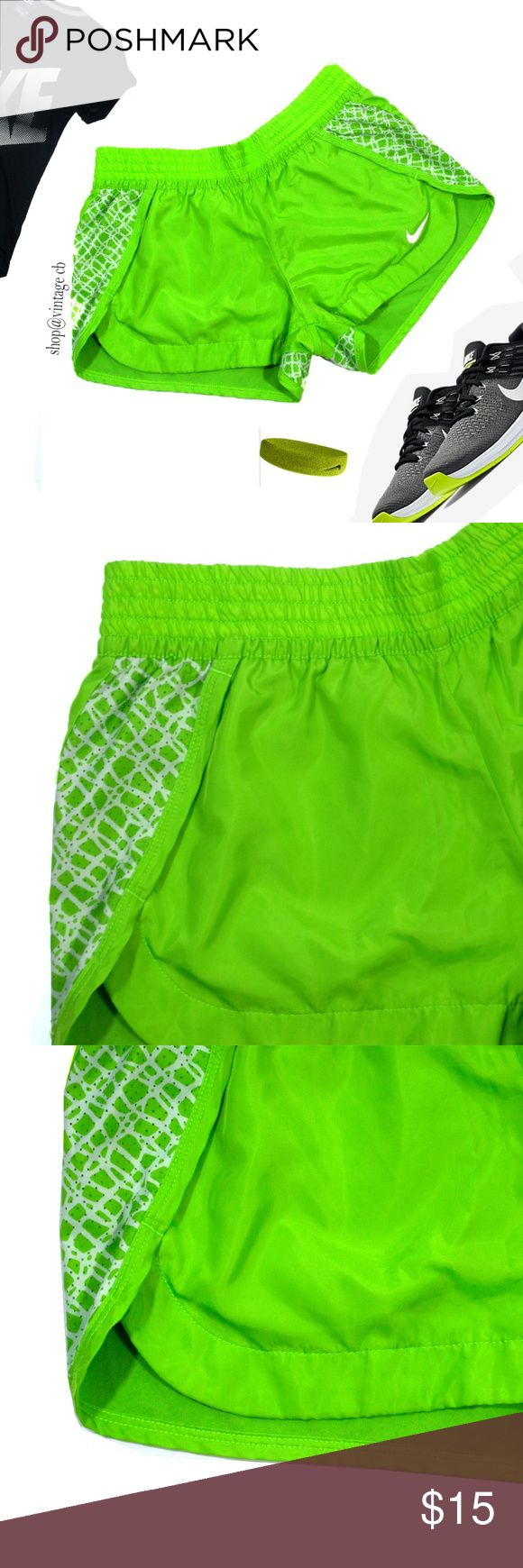 "Nike Dry Fit Neon Green Running Shorts Small Nike Neon Green Shorts with elastic waist band and  Contrasting Trim Very comfortable and in like new condition.   Size: Small Waist: 28"" (can stretch with Elastic) Length: 11"" Nike Shorts"