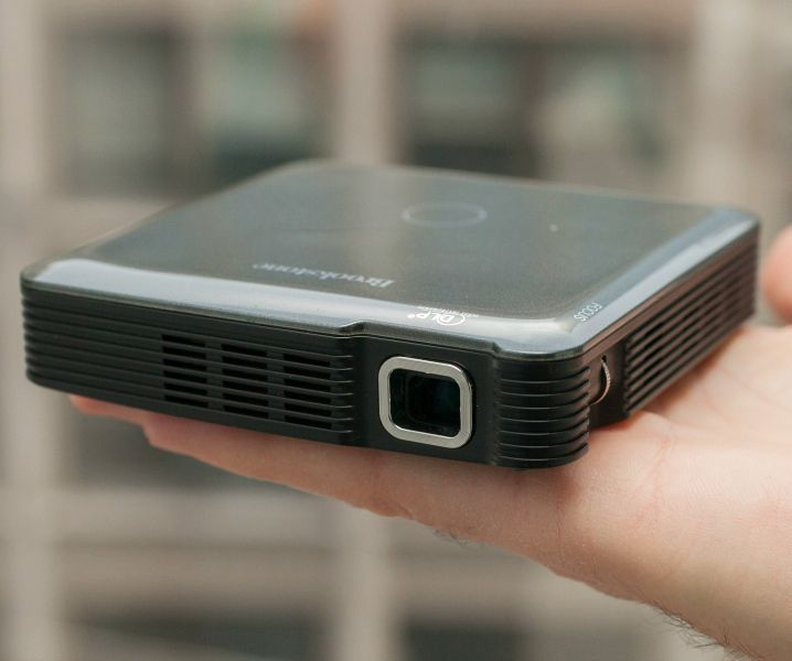 """Go big with our pocket-sized HDMI projector. Projects up to 1080p HD images up to 60"""" diagonal. Rechargeable and portable."""