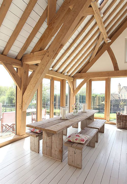 loving … this renovated barn with high ceiling and beautiful beams. The barn is attached to a Cotswold stone house and is located in the UK.
