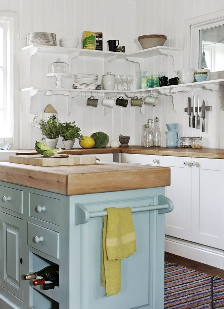 white cabinets & splash of color with blue island. So simple, clean and nice to look at.