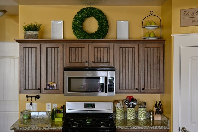 wreath on top of cabinets interesting way to add some