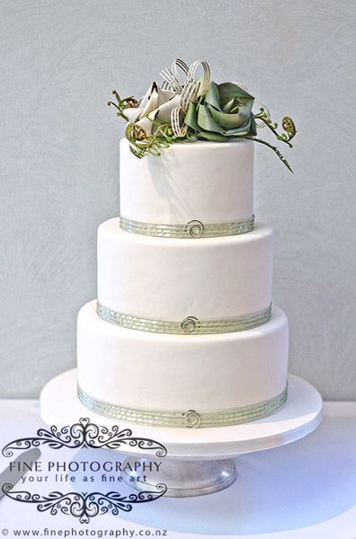 Three flower cake topper with fern, koru and flax flowers. Flax Hapene cake bands with spiral clasps.      www.flaxation.co.nz