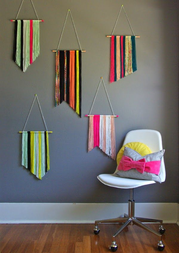Fun and easy idea. Hang colorful yarn over a dowel and trim in different ways. Easy backdrop for a dessert table or even a front door for a party.