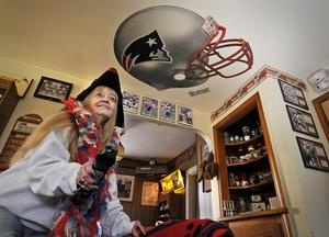 Paula Fields is ready to watch the Patriots on television in her Rockland home on Friday, Jan. 18, 2013, two days before the football team plays the game that will decide whether they will go to the Super Bowl. Fields has been a fan since childhood, when she watched games with her father, and a season ticket holder since 1978.