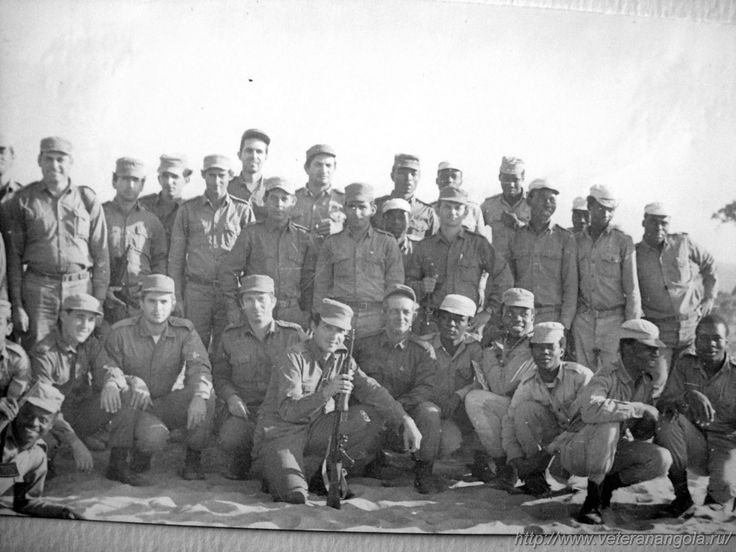 """Cubans and Soviets pose together at Camp """"ZAPU Bohm"""" in Luena, Angola. Photograph taken sometime during 1979."""
