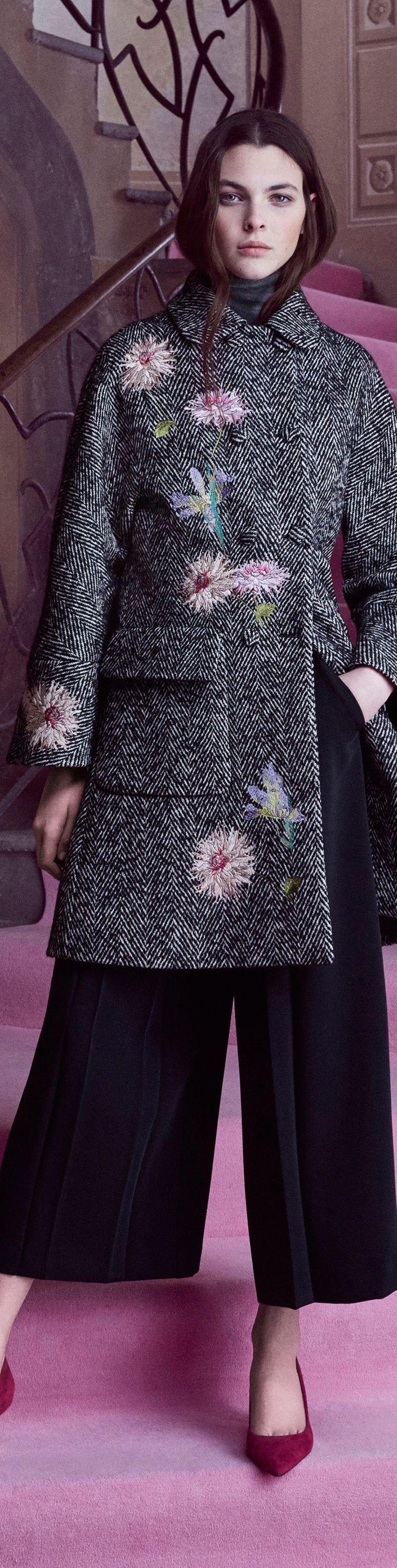 Blumarine Pre F-16: embroidered herringbone coat, grey turtleneck top, black culottes, fuchsia pumps.
