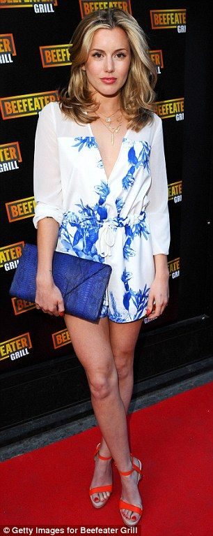 Stylish: Caggie Dunlop sported a white plunging dress with a distinctive blue floral print...