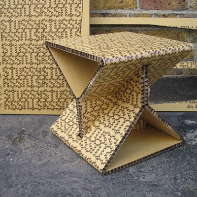 Hextable recycled cardboard  Designed by Wilson Brothers for Stussy, Hextable is an occasional table made from two identical components that is folded and locked into place. Fully recyclable, the honeycomb core table is incredibly light at 1.2kg, yet strong structurally.  Hextable is comissioned for Stussy Japan, after the success of the limited edition Stussy Chairfix created for the Stussy store in London. The product is hand screen printed in London with a Stussy pattern.
