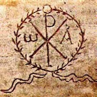 CRISMÓN. Simbolo cristiana que representa a Cristo con la superposición de las letras griegas P (ro) y X (ji). Primeras letras del nombre de Cristo. Las letras  alfa y la omega simbolizan, por otro lado, el principio y el fin.