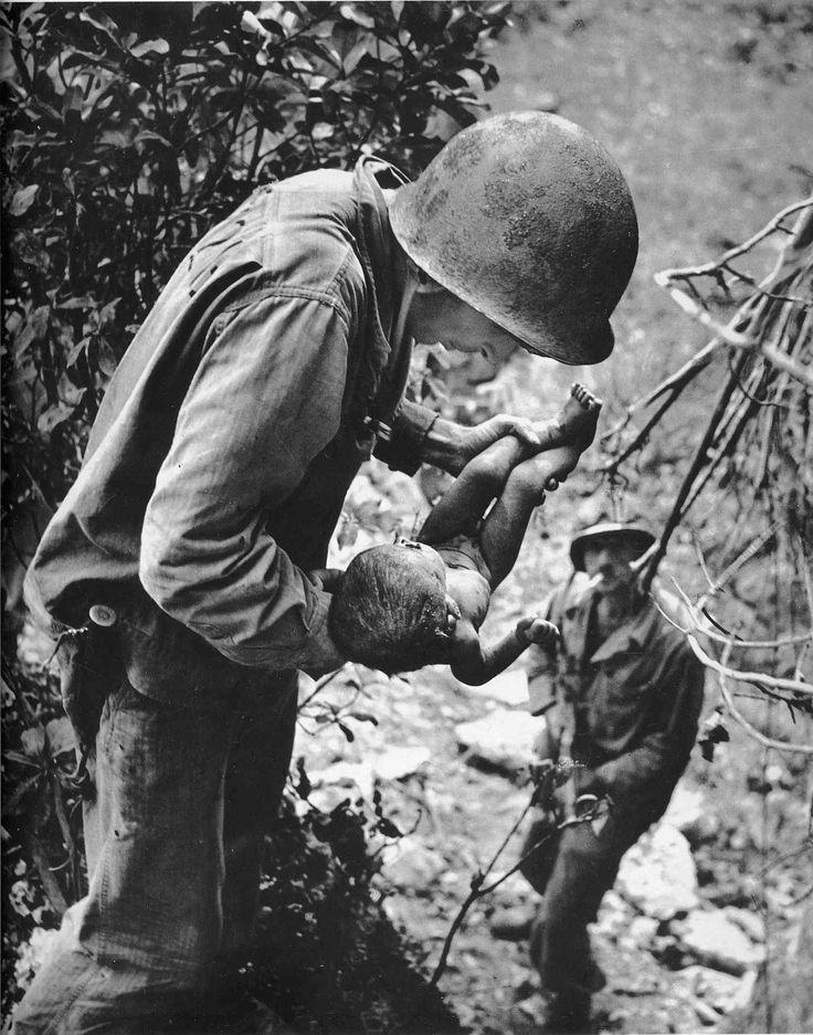 W. Eugene Smith WORLD WAR II. // The Pacific Campaign. June 1944. Battle of Saipan Island. US. (Littlest Survivor).