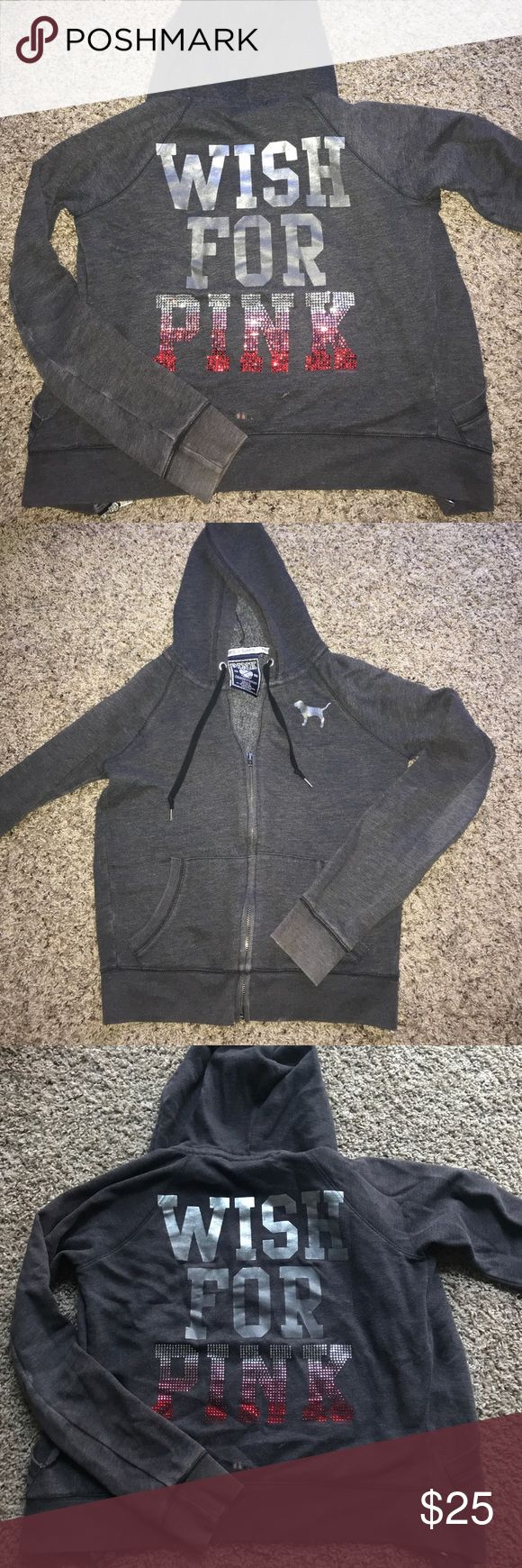 PINK VICTORIAS SECRET ZIP UP HOODIE Dark Gray. Metallic dog on front. Worn several times, in good condition though! Zipper is functional. All crystals on lettering are still in tact! There is a very tiny bleach mark on the back of the jacket towards the bottom  (I added a photo of this) super comfortable and cute for lounging and the holidays!! 🎄 PINK Tops Sweatshirts & Hoodies