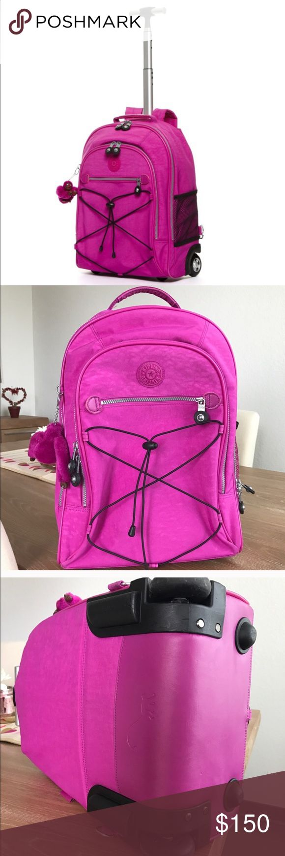 """🚨SALE🚨SAULITO KIPLING ROLLING BACKPACK Excellent conditions. Used only once. Color Pink Orchid (sold-out). Airline CarryOn Acceptable. Dimension: 13""""-17""""-8"""". Weights 5lbs.(I will pay extra shipping to send it to you).Will come with warranty tags. Hide away padded backpack straps. U-shape zipped, 1 interior pocket. Two zipper pockets front. One small mesh pocket. All zipper functionals. No rips or holes. Water resistant.Includes monkey. Retail price $199. NO TRADES. ONLY SERIOUS BUYERS…"""