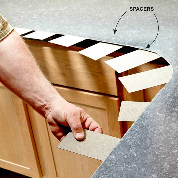 Use Spacers to Install the Top - Installing Laminate Countertops: Build a laminate countertop from scratch Read more: http://www.familyhandyman.com/kitchen/countertops/installing-laminate-countertops