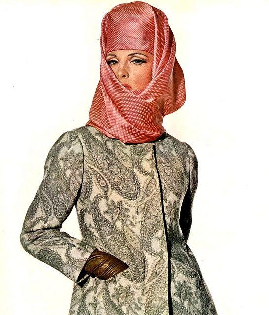 Balenciaga coat and Halston hat    Model Mirelli Pettini is wearing a coat by Balenciaga and Hat by Halston.  She was Photographed by Penn.Vogue,February 1965.