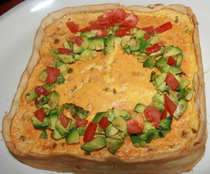 Savory Salsa Cheesecake Christmas appetizer topped with a wreath made from diced tomatoes and avocados It was a shame to cut it, but everyone loved it! ~bzb