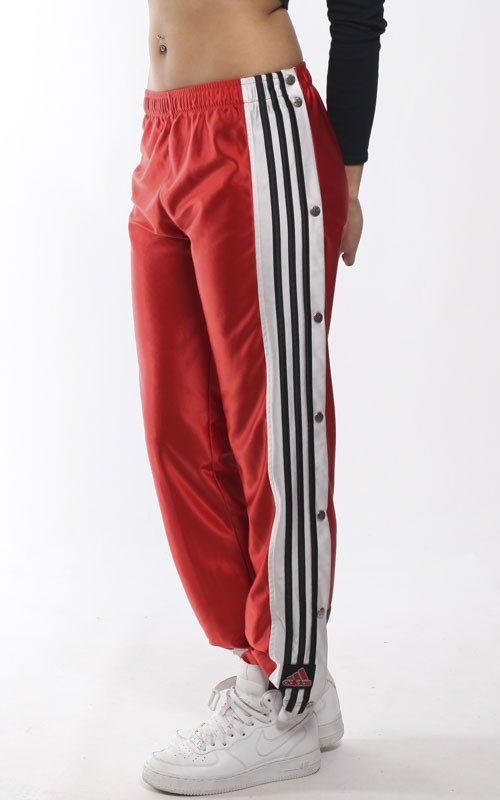"""Vintage Adidas tearaway pants with with snap fasteners running up the sides of both legs and elastic waistband MeasurementsEstimated Size: Small (Youth L)Waist: 26-28""""Length: 38"""" Condition: Good vintage condition"""