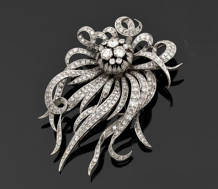 Flower brooch mounted en tremblant in white gold. c1960. Photo Piasa