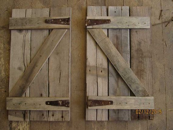 Rustic Shutters by Bessiesartandmusic on Etsy - possibly DIY a Z shutter with rustic hinges (for looks) and real hinges (operational) to cover the electrical box