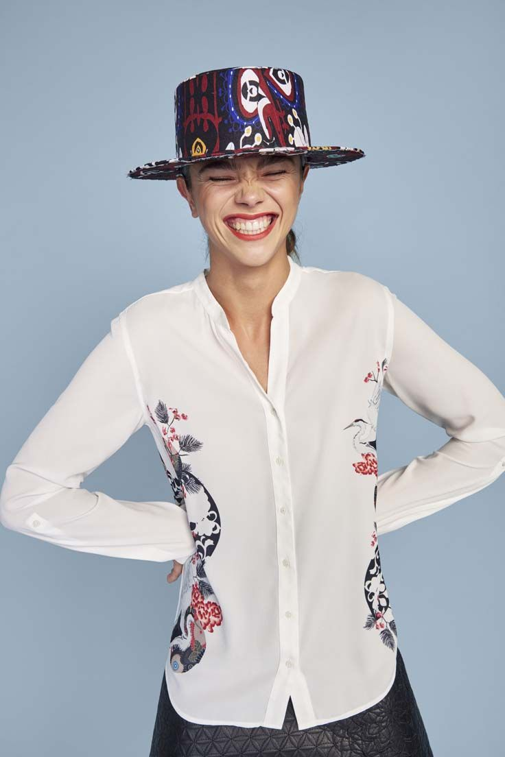 We're updating some of our seasonal staples with this sheer white shirt with a sophisticated but fun print at the side.