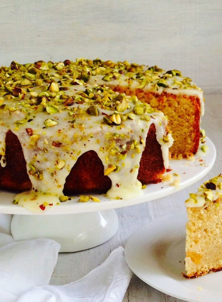 This is a gorgeous, generously sized coconut cake filled with juicy pieces of nectarine and topped with a tart lemon icing.
