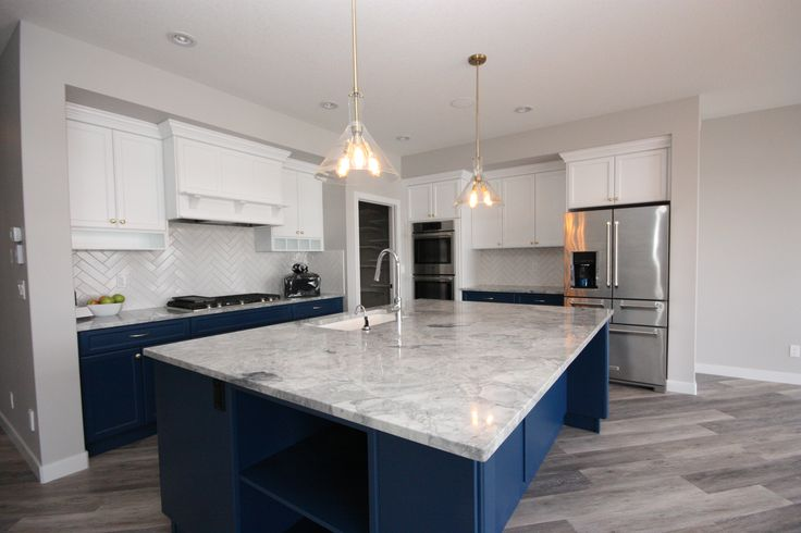 Kitchen, modern pendant lights, 2 toned cabinets, big island