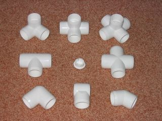 PVC PIPE FITTINGS=======Family Gathering of Furniture Grade PVC Fittings. End Cap is in the Middle. Slip Tee, Lower Middle. Notice How the Ends are Beveled for a Cleaner, Sleeker Look.
