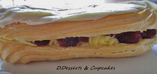 ALL Homemade Éclair; filled with cherry jam, custard, and white chocolate ganache topping.....to die for !