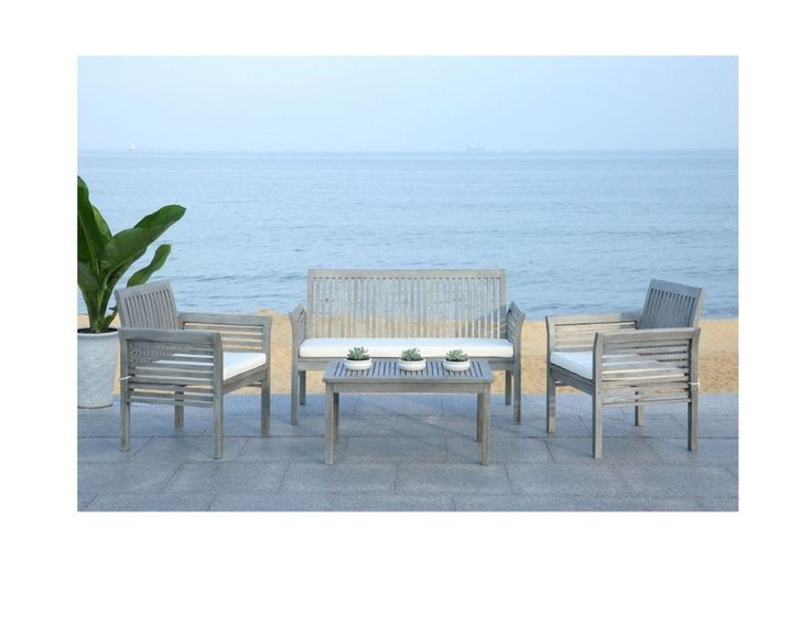 Grey Outdoor Furniture Set with Table - Outdoor Patio Furniture Set (4-piece)    Clean and contemporary, this gorgeous 4-piece outdoor furniture set recalls the simplicity of Danish furniture design. Masterfully crafted of sustainable acacia wood in a grey wash finish, this set comes with beige all-weather cushions for easy-care comfort.