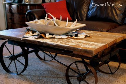 Coffee table: Chunky lumber with a touch of chippy white paint, iron wheels