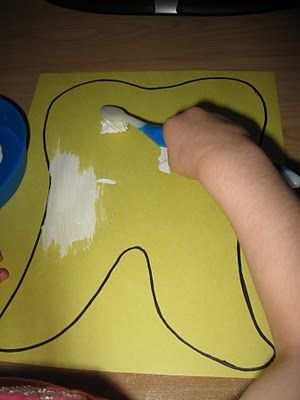"Doctor Week: Tooth art, painting a yellow tooth with white paint (""toothpaste"")…"