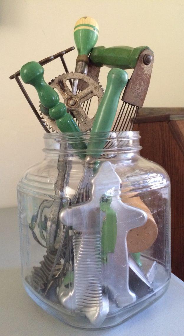 Vintage kitchen items on display in hoosier jar.