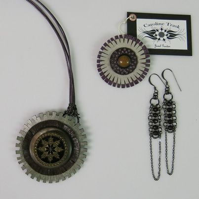 IN PURPLES... Broach and pendant necklace in vintage buttons of carved tagua nut and molded glass on cut leather backings. Pendant necklace on fine quality purple leather cord with chain link and clasp at the back. www.carolinetrask.com